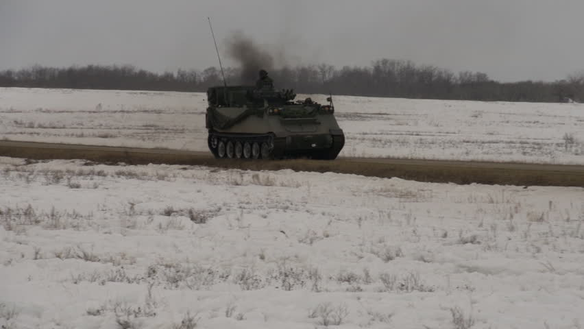 ALBERTA, CANADA, April 2013. Military, M113 armoured personel carrier on road fast - HD stock video clip