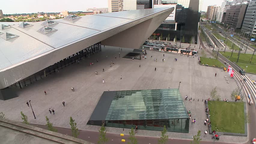 Top shot from Rotterdam Central Netherlands.  The new entrance to the Central station Rotterdan.  we see Trams and cars and people walking