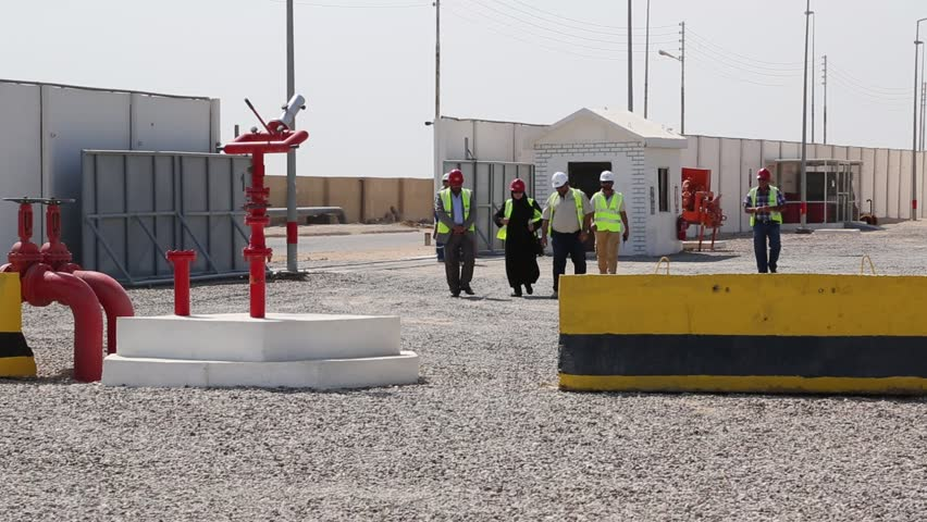 Basra, Iraq, October 2014: Iraqi Oil Depot Employees Walk through the Oil Terminal Compound in Basra, Iraq, October 2014.