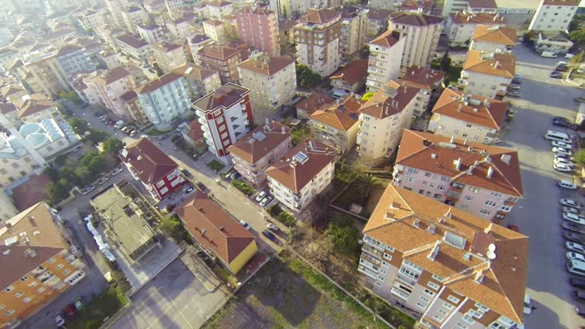 Top down of streets and houses. City scene over Maltepe. High altitude Istanbul view
