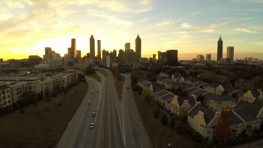 Atlanta aerial flying upwards with cityscape sunset view.