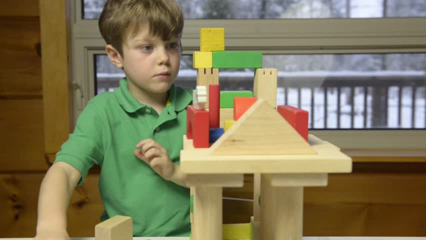 Young boy builds block construction in school classroom - HD stock footage clip