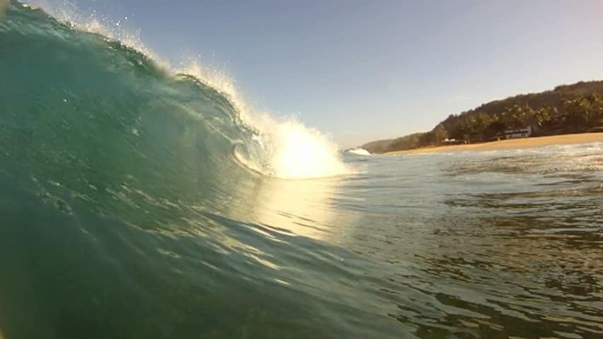 2 Shots of ocean waves breaking over the camera in Hawaii.