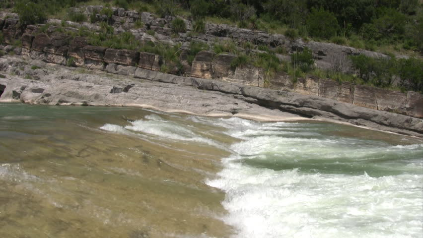 Video of wide waterfalls and river in pedernales state for Smooth river rocks for landscaping