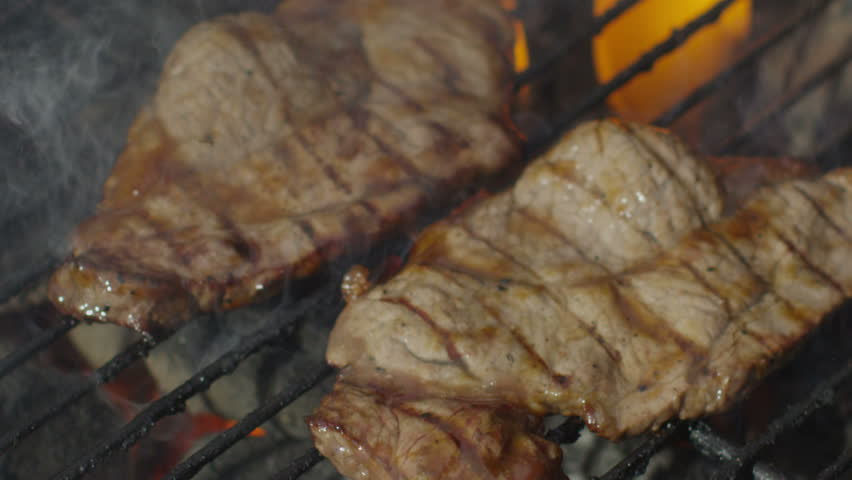 Grilled meat on a barbecue in summer