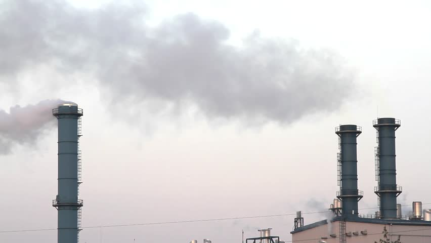 Smoke from factory chimneys over grey sky and clouds. Industrial pollution. - HD stock video clip
