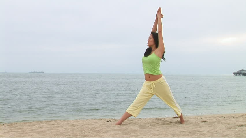 Woman doing yoga at beach - HD stock footage clip