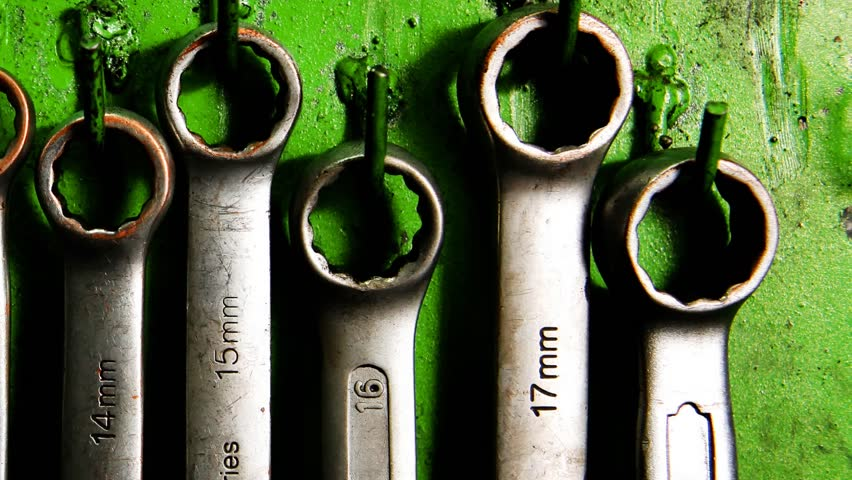 set of real used stainless spanners on green wall 1920x1080 intro motion slow hidef hd