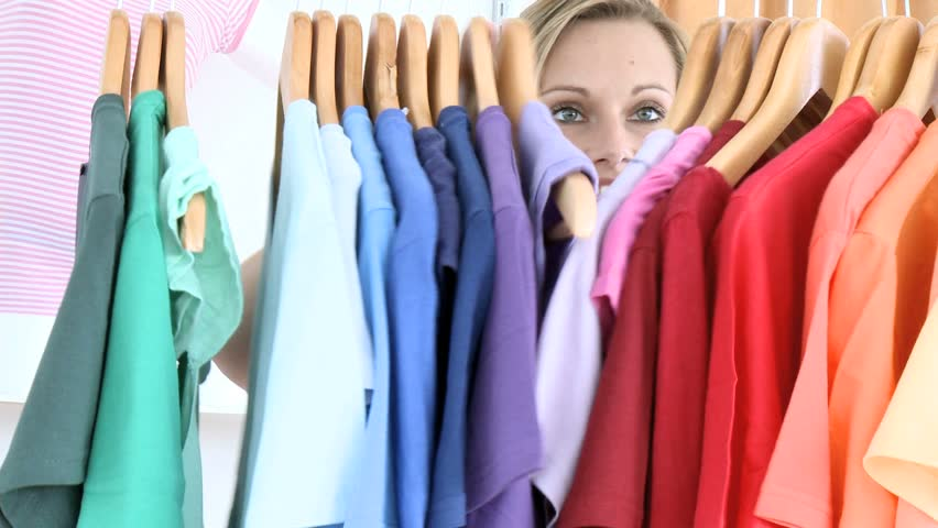 Woman shopping for t-shirts - HD stock video clip