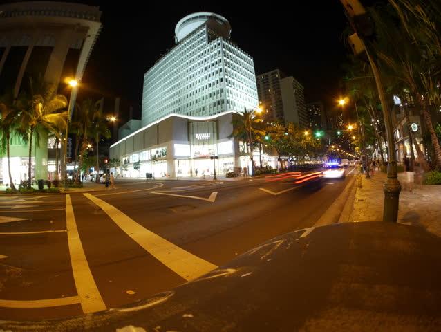 Honolulu, Hawaii - June, 2014 - Panning timelapse at the intersection of Kalakaua and Royal Hawaiian in Waikiki at night.