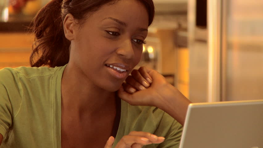 Young woman working on laptop at home - HD stock video clip