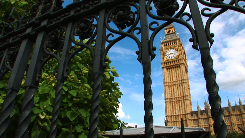 A wide shot of Big Ben through a gate. - HD stock footage clip