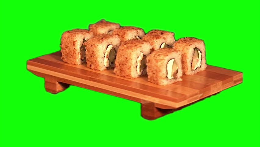 """Sushi (rolls with rice, smoked sea eel, cucumber, cheese """"Philadelphia"""", shaving tuna) on the wooden stand rotating on green screen,  - HD stock video clip"""