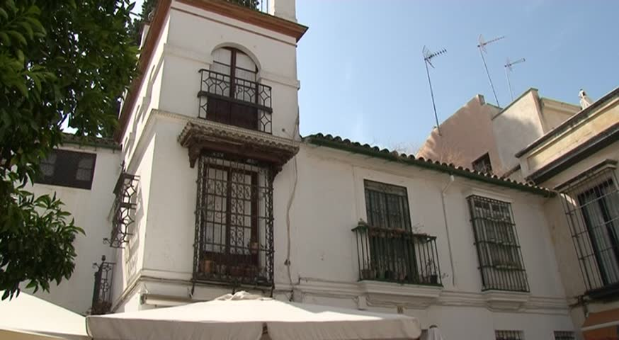 Old house and street in seville spain stock footage video Seville house