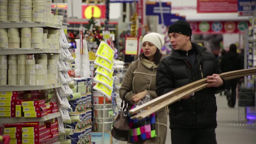 SAINT-PETERSBURG, RUSSIA, NOVEMBER 2013: Unknown buyers with lumber in hardware store.