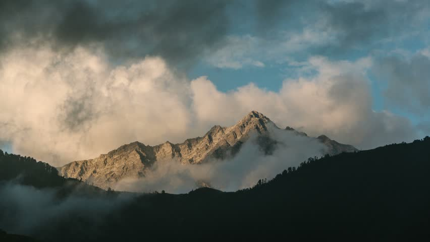 Timelapse of clouds & mist engulfing the mountains of Himalayas / Himachal Pradesh, India_HQ