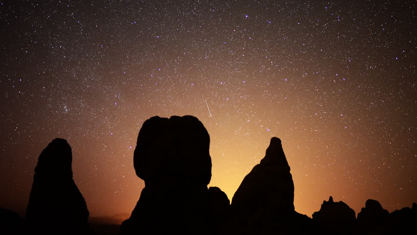 4K Astrophotography time lapse footage with pan right motion of starry sky over monolithic formations in Trona Pinnacles, California