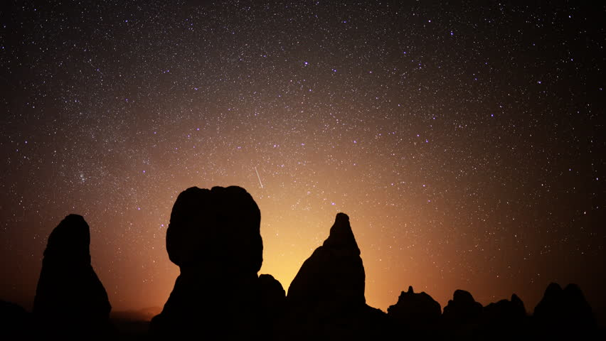 4K Astrophotography time lapse footage with zoom in motion of starry sky over monolithic formations in Trona Pinnacles, California