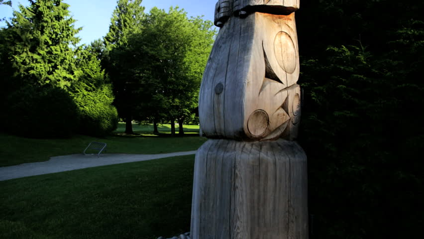 Totem Pole North American tribal culture handcrafted freestanding carvings statue Stanley Park Vancouver British Columbia Canada - HD stock footage clip