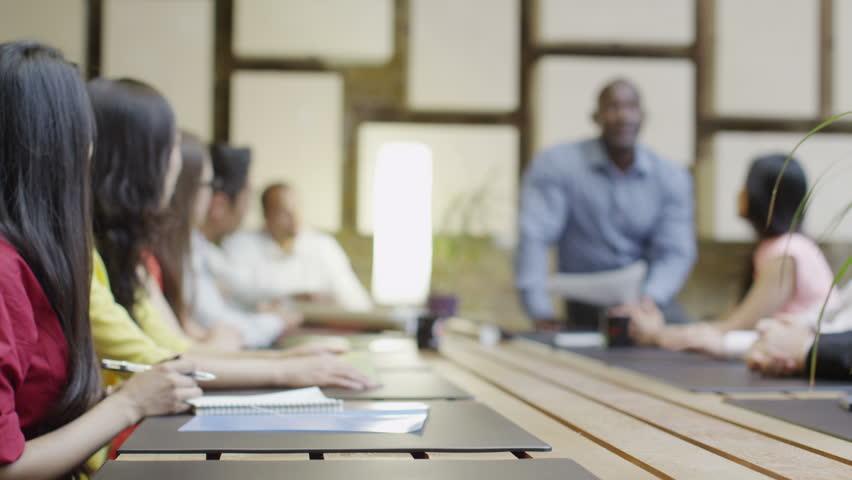 4K Mixed ethnicity business team in boardroom meeting applaud the speaker