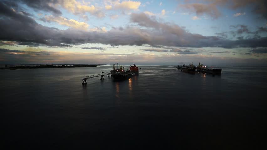 FREEPORT, BAHAMAS - NOVEMBER 12, 2014: Overhead shot of a TORM cargo ship during sunset. 1080p HD.