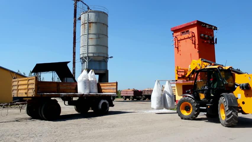 Loading fertilizer application ; Loading fertilizer with special forklifts,video clip