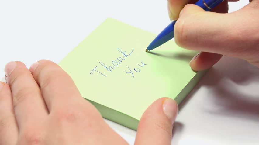 Woman Writes Thank You on a Self Stick Notes. 4K Ultra HD 3840x2160 Video Clip