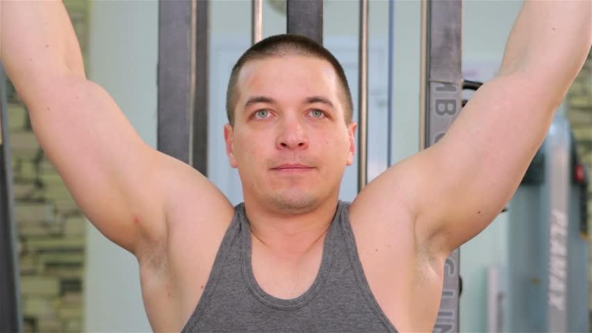 A man trains in a gym