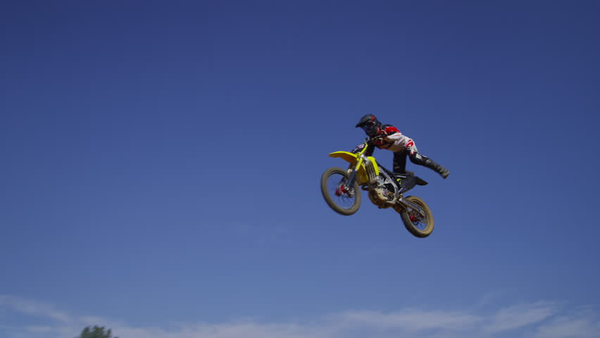 Motocross rider going off big jump, slow motion, 4K shot on RED Epic