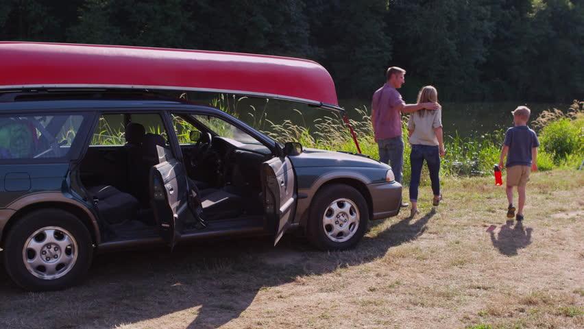 Oregon, USA - August 1, 2014: Family parks car at campsite