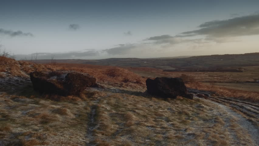 Moorland scene HD stock footage. A Autumn/Fall seasonal scene of an English Moorland with snow laying on the ground and Autumn/Fall colours. ProRes 422.