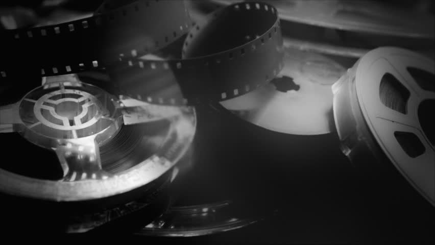 Vintage film stock and audio reels in black and white HD stock footage. A superb collage of vintage Movie making materials ideal for a Film or Movie related presentation with a vintage look.