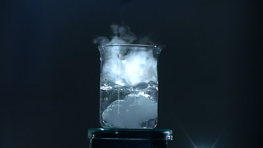 Dry ice sublimation in water with bubbles and fog
