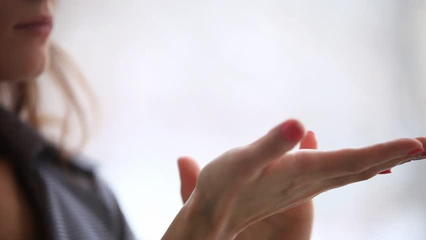 Woman applies cream on her hands. HD. Close up. 1920x1080