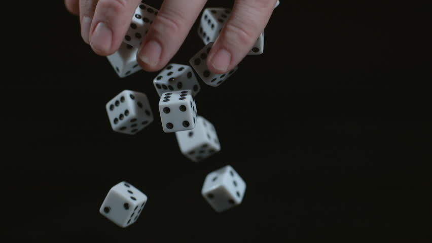 Tattooed hand dropping dice in slow motion; shot on Phantom Flex 4K at 1000 fps