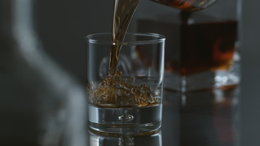 Whisky is poured into glass in slow motion; shot on Phantom Flex 4K at 1000 fps