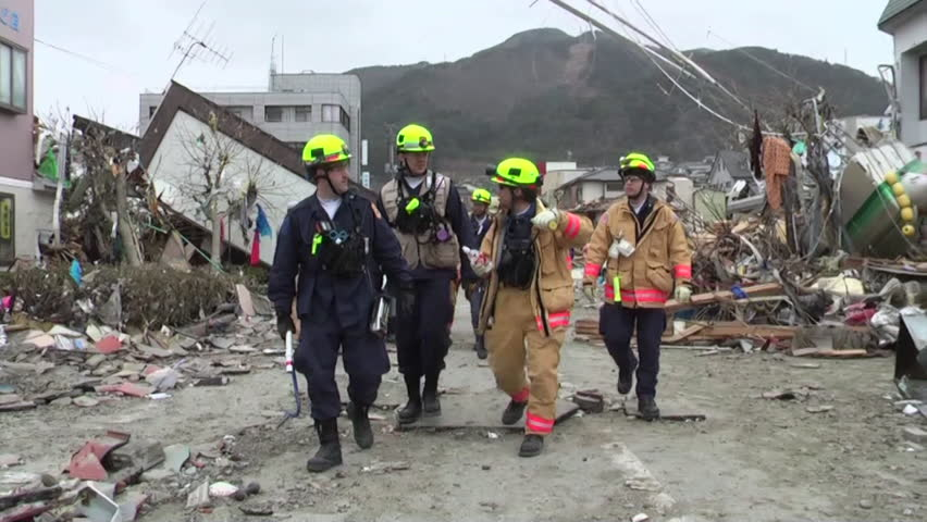 CIRCA 2010s - Search and rescue teams hunt for survivors following the devastating earthquake and tsunami in Japan in 2015