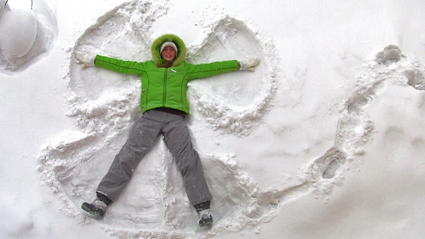 Snow Angel - playing in snow - HD stock footage clip