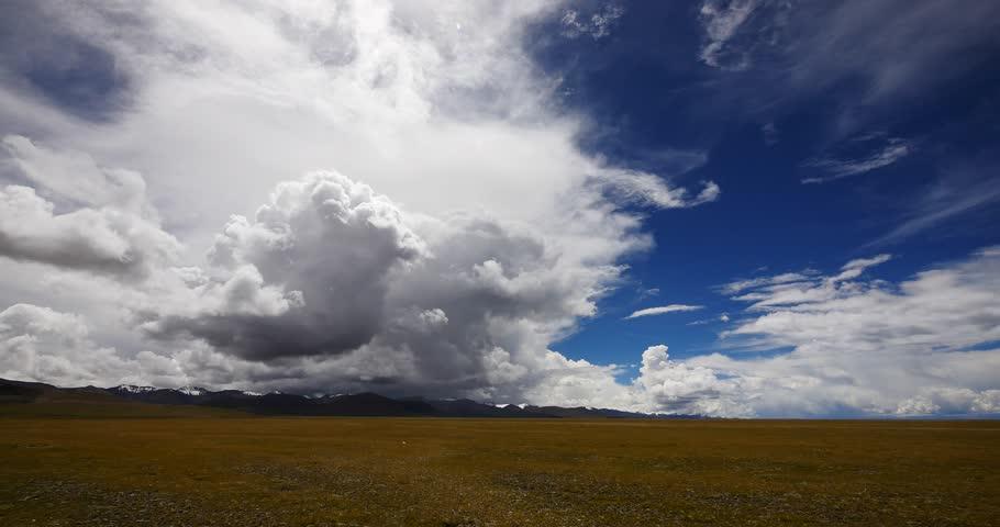 4k huge clouds mass rolling over namtso mountains,Danggula(Tanggula) Mountains in xizang Plateau,roof of the World. gh2_09242_4k