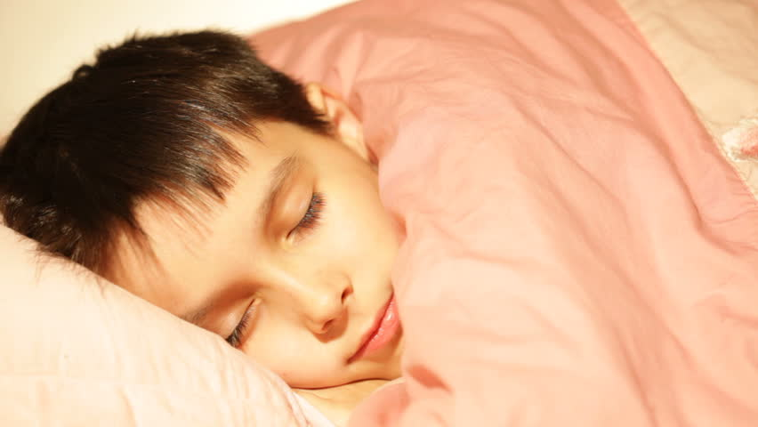 boy asleep, dreaming in his bed  - HD stock footage clip