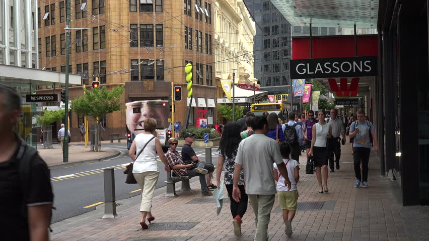 WELLINGTON, NORTH ISLAND/NEW ZEALAND - JANUARY 26, 2015: Unidentified crowd of people walk along Lambton Quay shopping street. Lambton Quay is the heart of the central business district