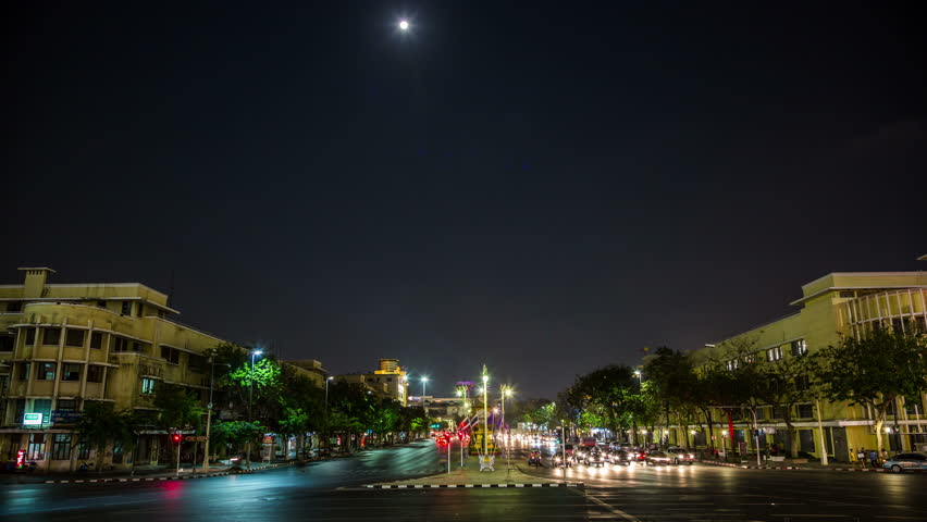 BANGKOK, THAILAND – March 5, 2015: Ratchadamnoen Klang Road with driving cars and Moon by night - DSLR Timelapse