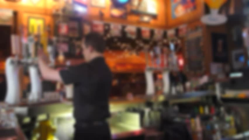 Soft focus, unrecognizable people at sports bar.