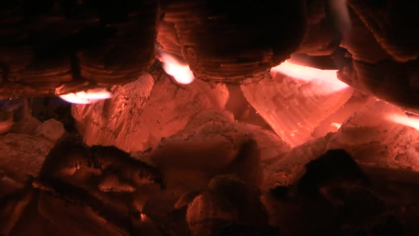 Embers of coal background - close- up. Campfire closeup. Natural background - HD stock video clip