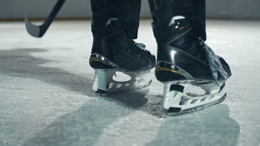 Low section of hockey player appearing on ice