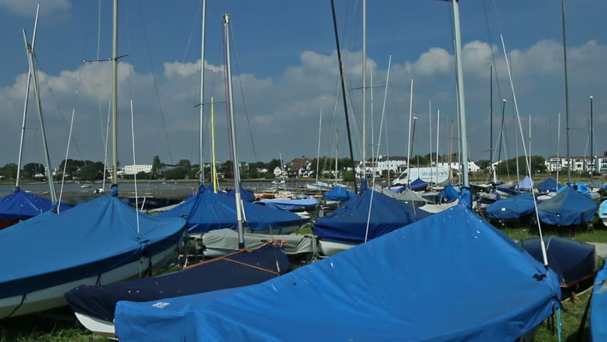 small sailing boats in storage