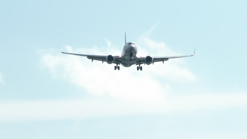 Airplane flying over head with landing gear down, take off or landing purposes.