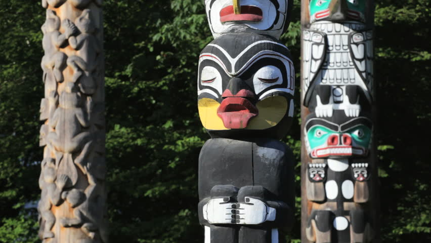 Vancouver, BC, Canada, downtown Stanley Park's collection of Native totem poles, dolly/ tracking shot - HD stock footage clip