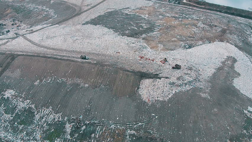 Landfills With Tractors : Aerial shot of trucks and tractors working in landfill