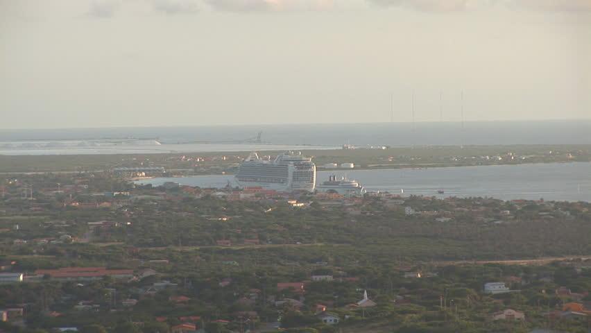 Tropical island Bonaire - zoom with cruiseship - HD stock video clip